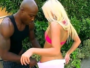 Blonde hottie Jessie Volt kneels and deep blows this black dudes huge cock