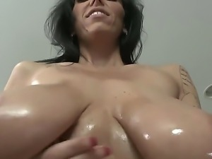 Busty babe Alia Janine shows her oiled body and sucks a big and tasty dick
