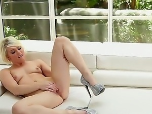 Young gorgeous girl Ash Hollywood is posing nude but in glamour heel shoes...
