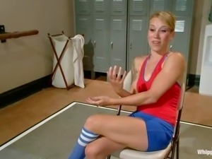 Gymnast Bella Wilde in red and blue uniform gets trained