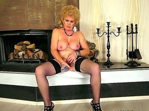 Busty grandma Effie shoves a new dildo in her shaved pussy in front of the...