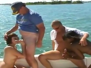 Two big busted brunettes enjoy giving a sloppy blowjob to a mature guy till...