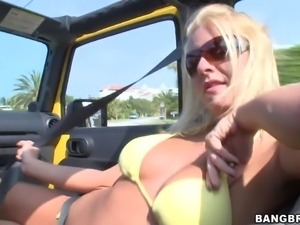 Playful blonde Riley Evans with big natural boobs takes off