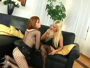 Redhead and blonde hotties Jess and Lana Blond stay in sexual outfits before...