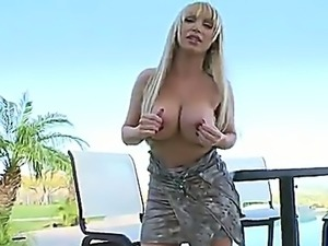 Sexy blonde with incredible curves Nikki shows her cute holes before toying...