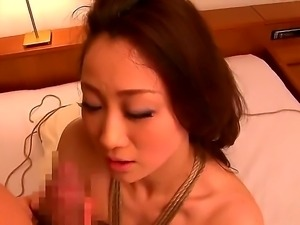 Yu Kawakami has her tits tied with a rope and gets her pussy fingered really...