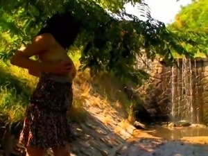 Busty teen plays naked in nature