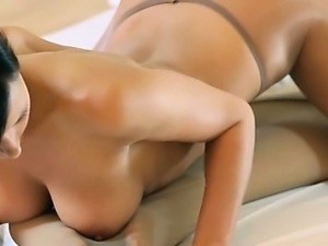 Horny young girls with strapon on sofa