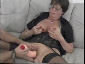 Mature granny Lena sucks on his hard cock and then uses dildo