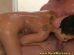 Asian massage babe enjoys soapy massage