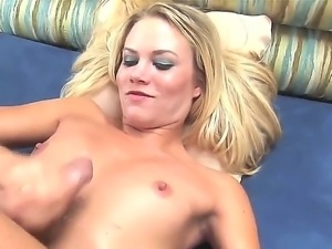 Raunchy blonde babe Sophia Lynn sits in front of her man while wanking his...