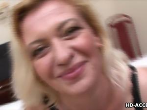 mature blonde sucks two cocks