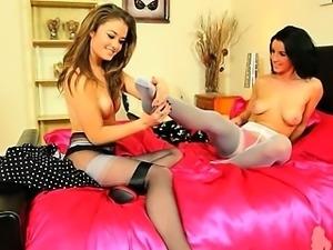 Two brunette lesbians teasing in nylons