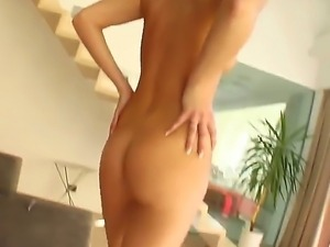 Attractive naked blonde slut Ally with provocative heavy make up and smoking...