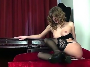 Amazing longhaired beautiful girl is going not only to strip but to play with...