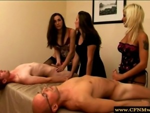 Group of femdoms humiliating subjects by tugging them