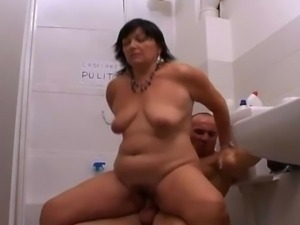 Mature busty slut getting fucked in a public toilet.