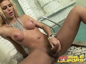 Enchanting blonde shemale Grazi showing big jugs and fuckable arse at the...