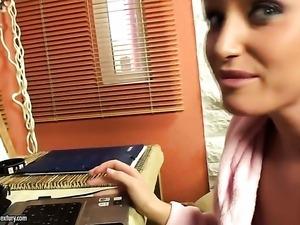 Blonde Kathia Nobili fingers her muff