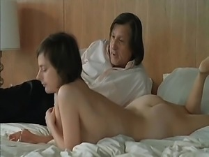 Isabelle Menke nude making out with some guy on the bed,