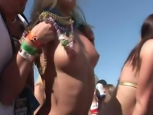 View these great babes flashing tits to the camera at a spring break party.