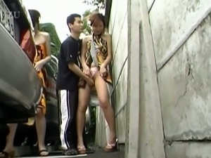 Two hot japanese teen babes sucks cock in street