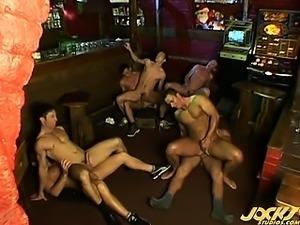 Mega hot hunks in a group orgy fuck fest happens in a bar
