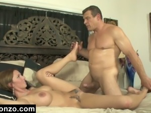 Muscular stud bangs a tattooed brunette very hard