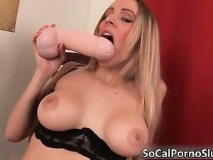 Sexy blonde hoe plays with a huge dildo