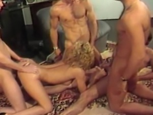 Retro babe Karen Summer is in the middle of a bunch of guys and turns the...