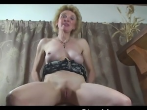 Busty mature ladies Caroline plays with her pussy through some pantyhose