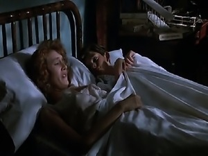 Laura Dern laying back with one breast exposed as a guy