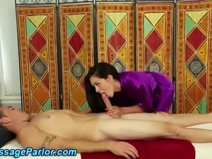 Asian masseuse sucks cock with her massage client in hd