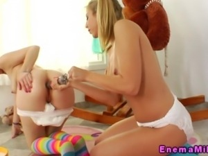 Milk enema cute girls fill up a cup of lovely love cream close up