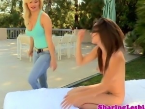Teen lesbian babes have sex outdoors