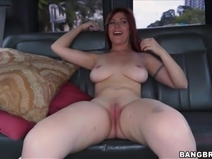 redhead girl enjoying cock sucking in a van