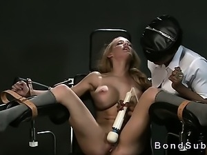 Strapped busty blonde in gyno chair squirting