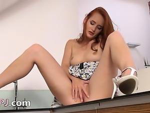 Pissing redhead teasing snatch