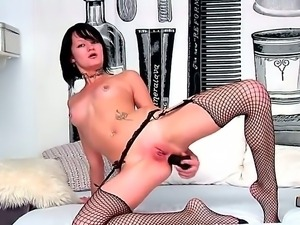 Tattooed princess Nova Black with pierced nipples curves on a bed in fishnet...