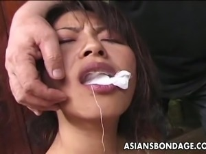 Hot japanese brunette  woman gets bound