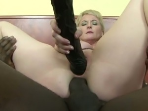 Blonde mature milf riding black cock in both holes