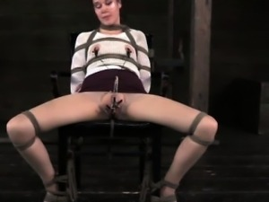 Clit clamped submissive wrapped in tape