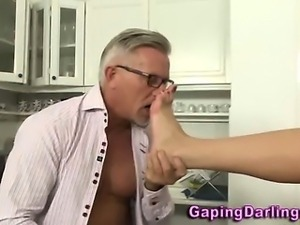 Babe gives footjob to old