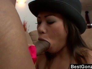 This hot petite Asian slut is dressed to fuck. Cute hat and sexy underwear...