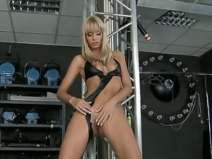 Erica Fontes has beautiful blonde hair and big tits. She undresses and...