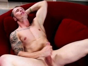 Gay tattooed hunk masturbates