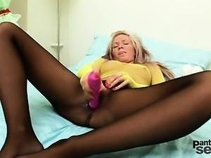 Cristal masturbating with a dildo through her pantyhose
