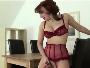 Mature redhead rides mechanical dildo