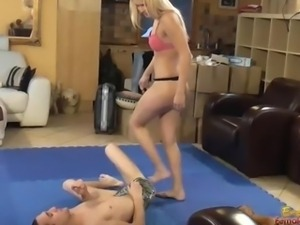 Facesitting Blonde dominatrix in pink bra and panty