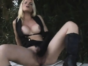 Shemale babe Samara DeMacedo tugs her cock outdoors